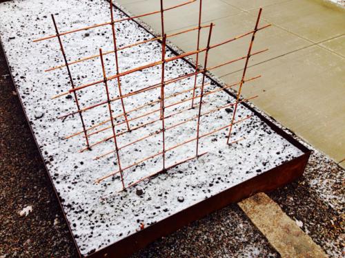 Snow in the garden, bamboo trellis