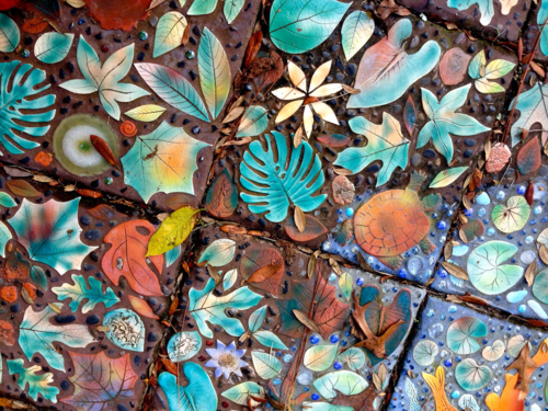 Raised relief tiles in leaf and flower designs